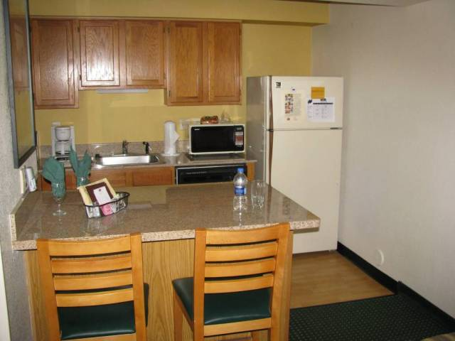 """Kitchen with stove around the corner."""