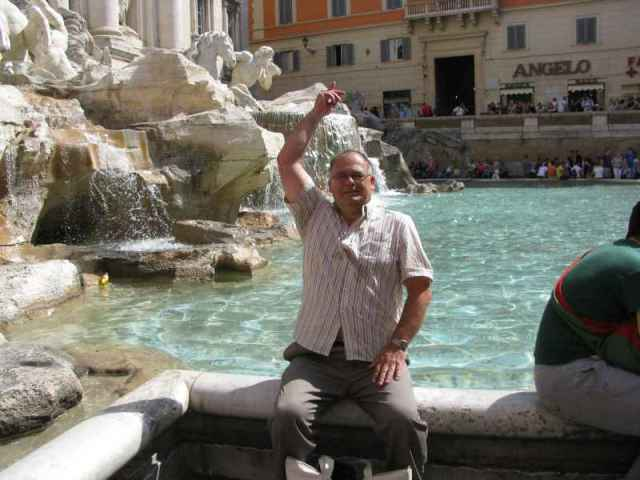 throwing my coin into Trevi Fountain