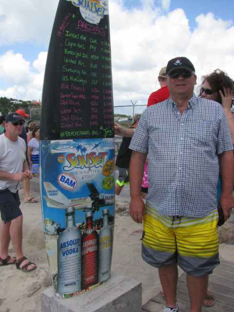 Yours truly beside the famous surf board telling you the times