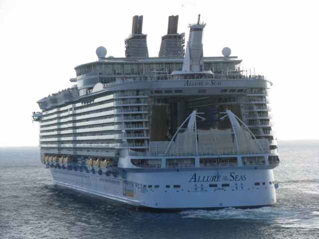 Allure of the Seas sails out ahead of us