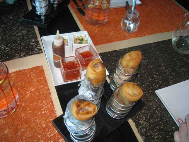 Chinese Spring Rolls - Note how they are served - in springs