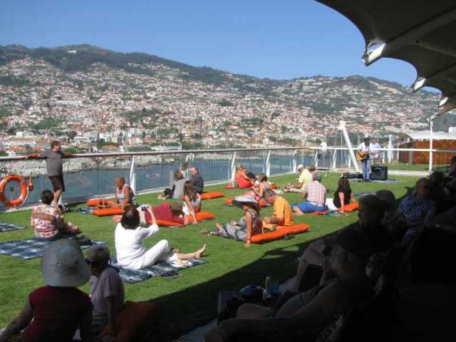 It is rough back on board. Real Grass and blankets and wine and cheese party as we sail away from Funchal